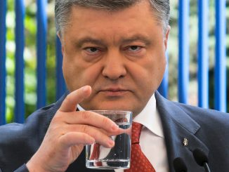 Ukrainian President Petro Poroshenko drinks a water as he listens to a journalist's question during his news conference in Kiev, Ukraine, Friday, June 3, 2016.  (AP Photo/Efrem Lukatsky)