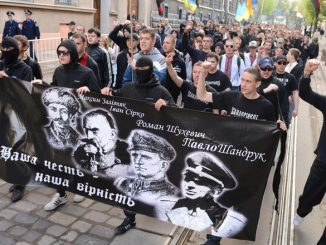 "Ukrainian ultra-nationalists march in the center of the western city of Lviv on April 28, 2013 to mark 70th anniversary of 14th SS-Volunteer Division ""Galician"" foundation. The 14th Waffen Grenadier Division was a World War II German military formation initially made up of volunteers from the region of Galicia with a Ukrainian ethnic background, but later also incorporated Slovaks, Czechs and Dutch volunteers and officers. Neo-nazis from Russia and Lithuania also took part in the march. AFP PHOTO/ YURIY DYACHYSHYN        (Photo credit should read YURIY DYACHYSHYN/AFP/Getty Images)"
